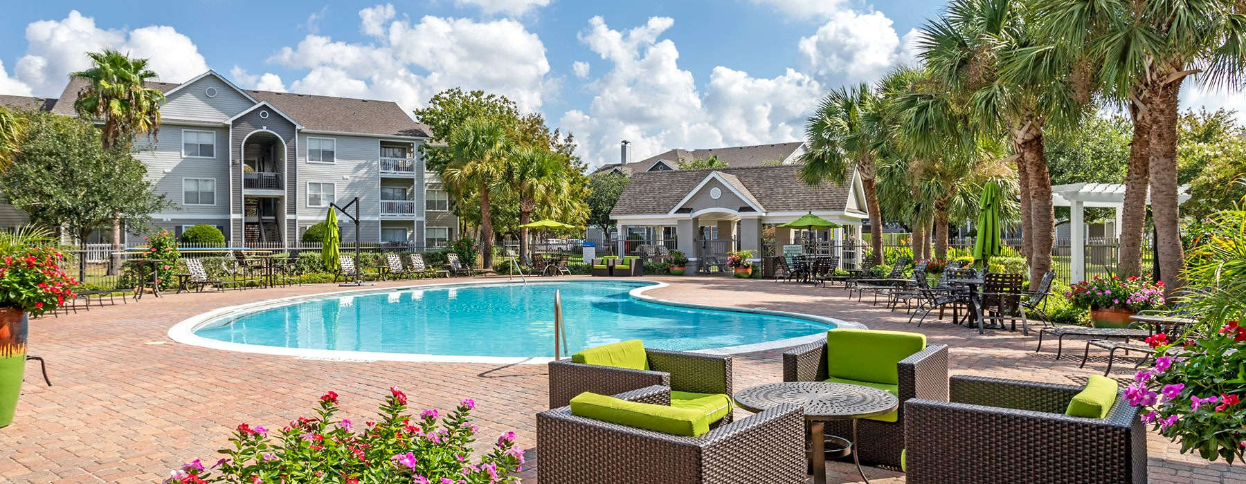 Large pool with shaded seating and clubhouse access.