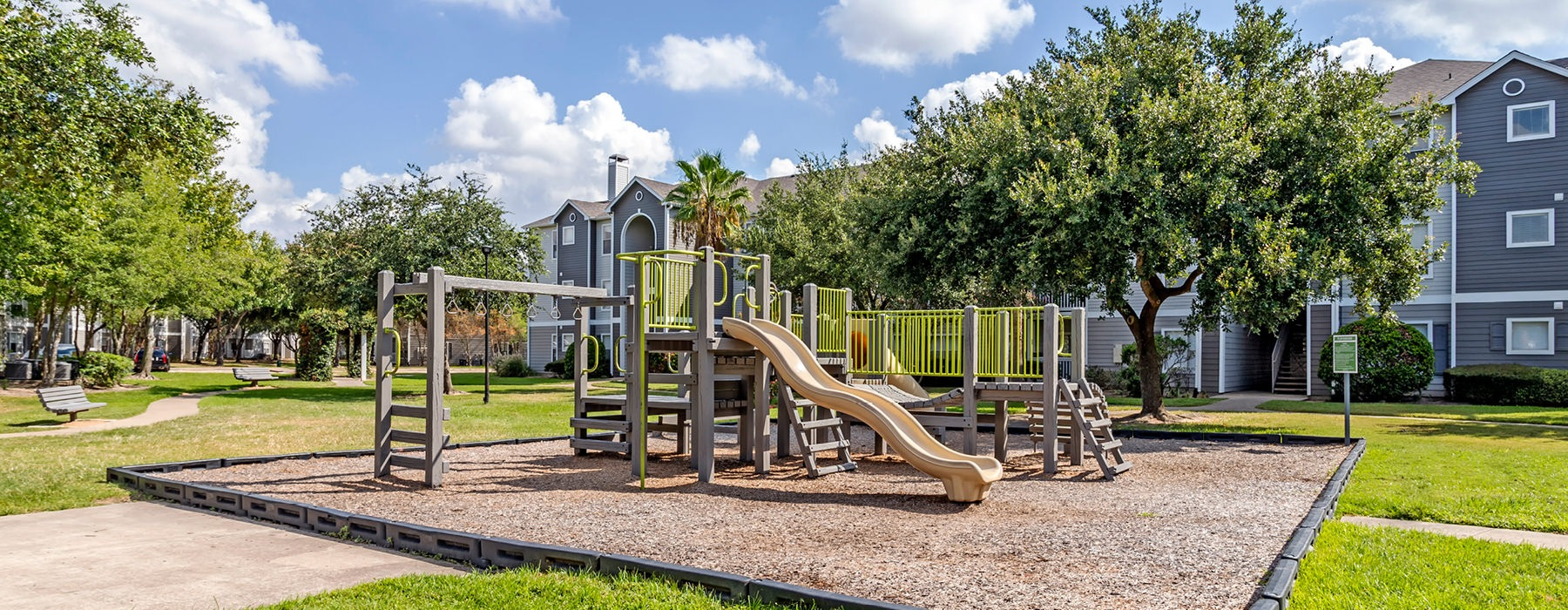 Large playground with wood chip ground.
