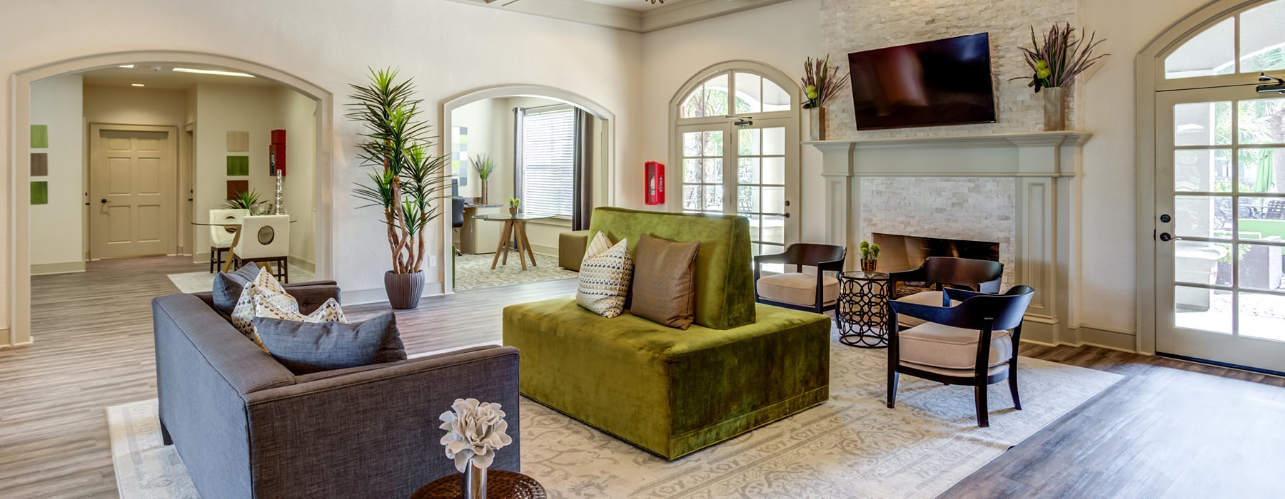 Large lobby couch seating, large TV and floor to ceiling windows for plenty of natural light.